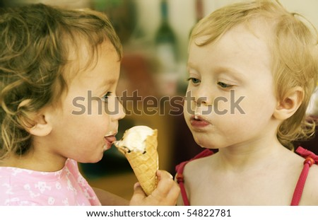 two little girls eating one ice-cream, retro colored