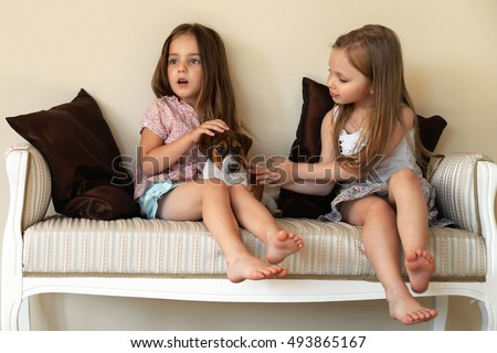 Two chicks in couch
