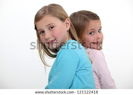 two little girls posing together