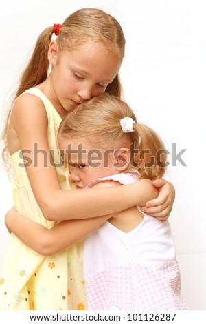 two little girls sad - stock photo