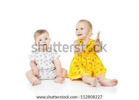 two little girls sit and play