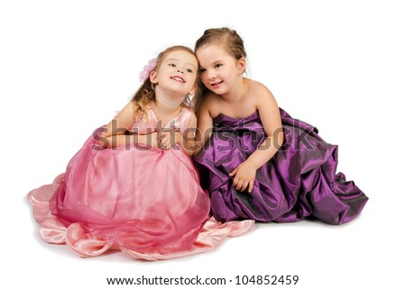 Two little girls speaking with each other isolated