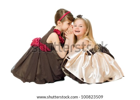 Two little girls talking. Isolated on white