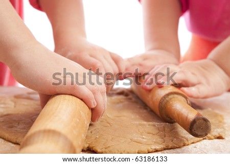 two little girls with rolling pins baking and having fun, hands only