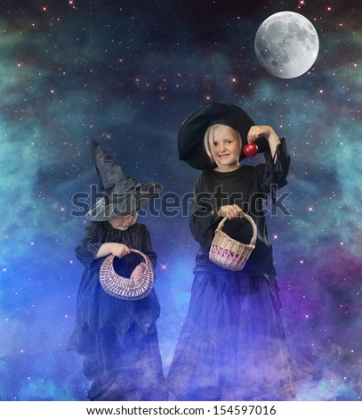 two little halloween witches, background with stars, space and moon