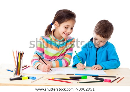 Two little kids at the table draw with crayons isolated on white