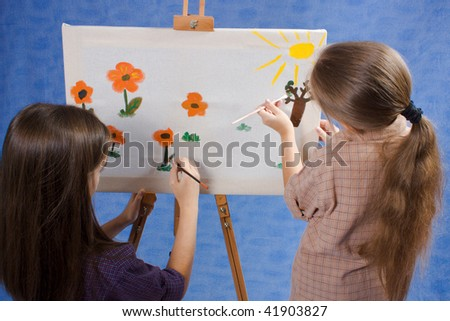 Two little painters drawing