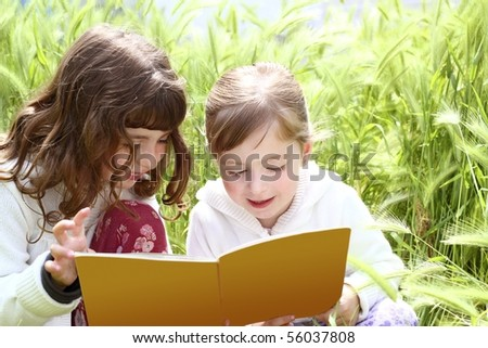 two little sister girls reading book spikes garden