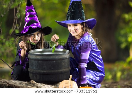 Two little witches cooking #733311961