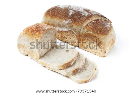 Two loafs bread on white background, one is sliced