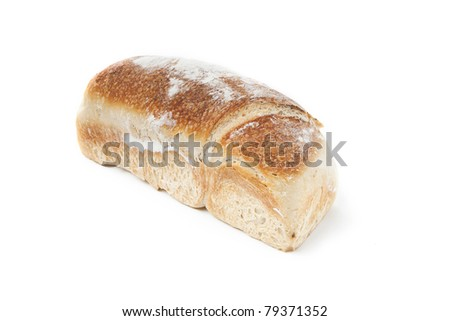 two loafs of bread on white background, one is sliced