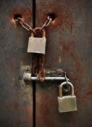 two lock on rusty iron door