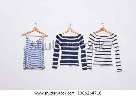 Two Long striped clothes and striped vest on hanging -white background  #1386264710
