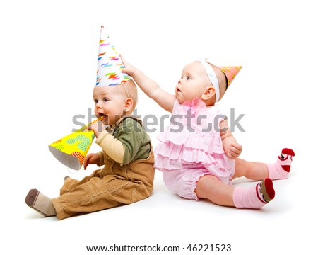 Two lovely kids with party hats on, isolated