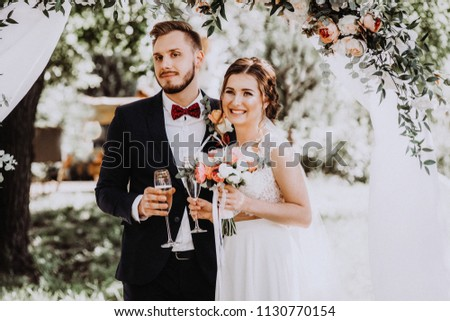 Two lovers hearts on the wedding ceremony. newlyweds with glasses #1130770154