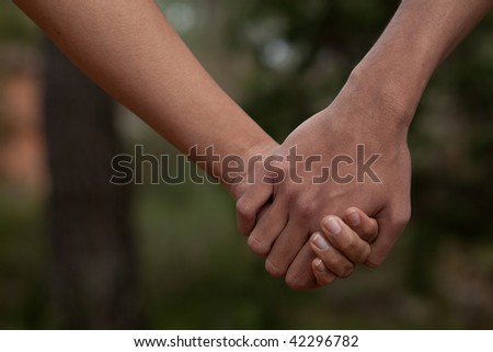 Two lovers holding hands