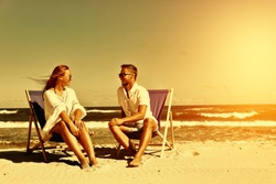 Two lovers on beach and summer time of golden color