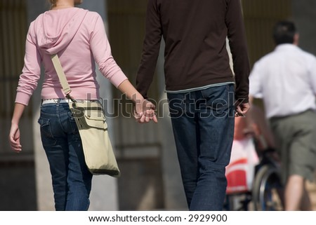 Two lovers walking hand-in-hand