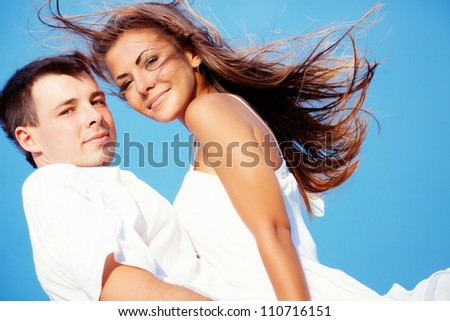 Two lovers with blue sky background