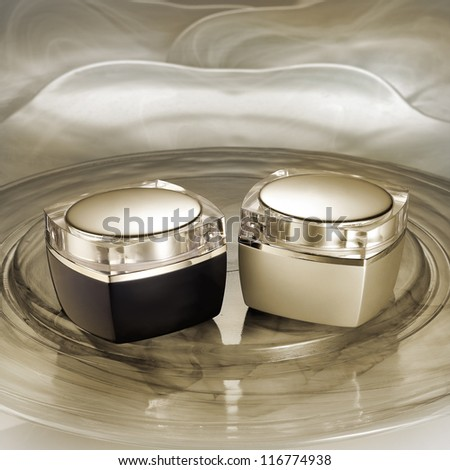 Two luxury cream containers on glamorous background