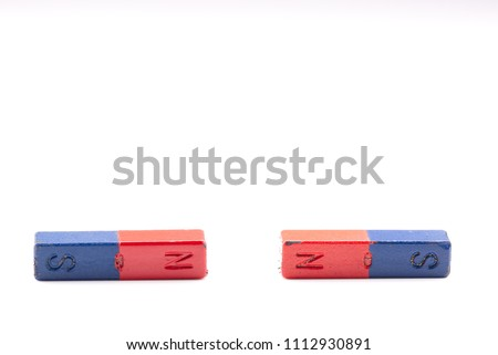 Two magnets repelling each other isolated on a white background. North – North repulsion. Science scientific concept