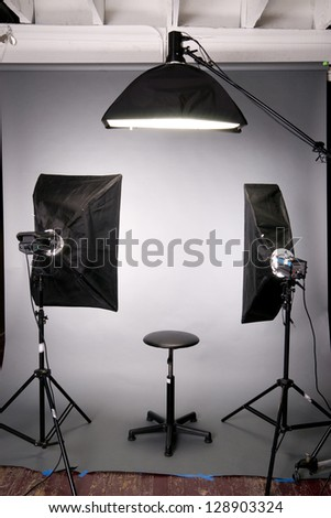 Two main lights a hair light posing stool on grey seamless in the photography studio