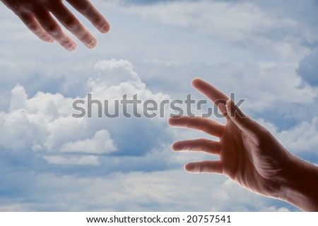 two male hands with fingers outstretched reaching out toward each other - stock photo