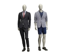 Two male mannequins dressed in suit Isolated on white background. No brand names or copyright objects.