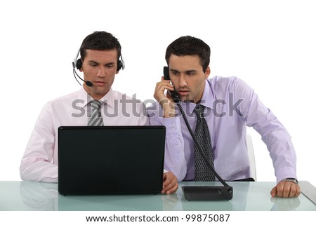 Two male telephone operatives
