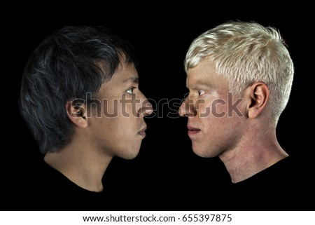Two man face to face, one european and the other american, look at each other, portrayed in profile on black background