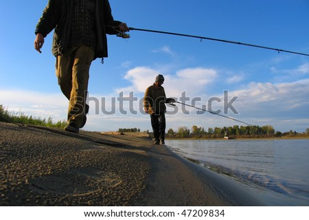 two man fishing on river