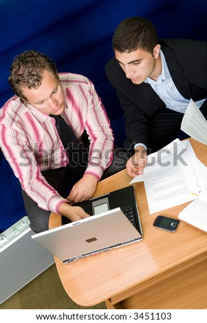 Two man having a business discussion in a hotel room