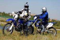 Two man on enduro sport motobikes