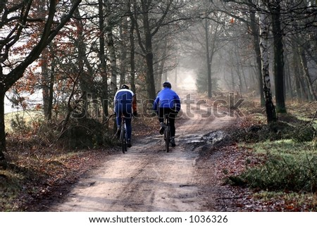 Two Man riding his bike in the park