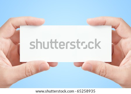 Two man's hands holding long blank paper business card on light blue background, copy space fot your message or adverisment