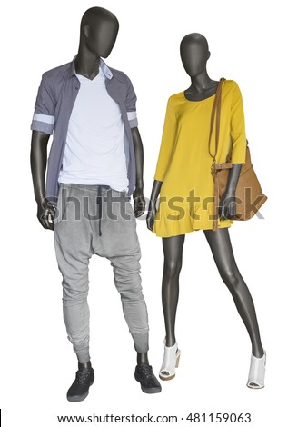 Two mannequins, male and female, dressed in casual clothes. Isolated on white background. No brand names or copyright objects.