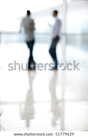 Two mans silhouette in hall of office building