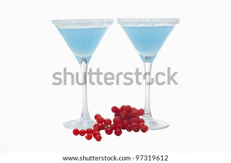 two martini glasses and berries