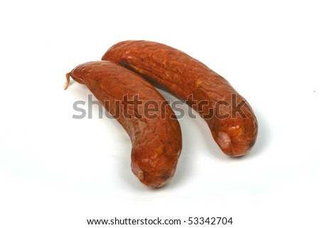 Two meat sausages on white background, isolated.