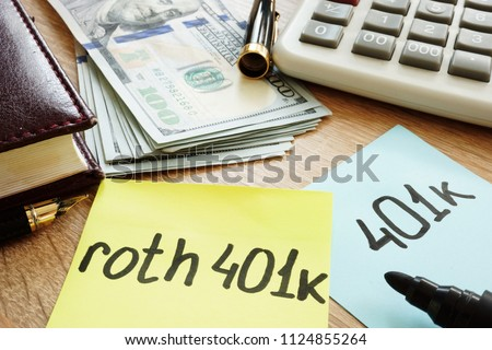 Two memo sticks roth 401k on a desk. Retirement.