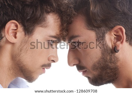 two men against each other for conflict and rivalry. - stock photo