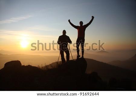 Two men at  a peak
