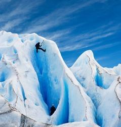 Two men climbing a glacier in patagonia. Copy space.