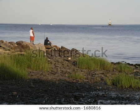 Two men fishing on the rocks
