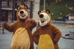 two men in a bear costume in the city, in day of protection of animals, festive entertainment