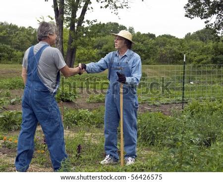Guys in Bib Overalls Two Men in Bib Overalls Greet