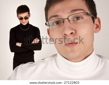 Two men in white and black clothing