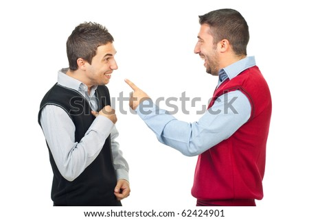 Two men laughing and have fun while one of them accusing the other  and pointing to him isolated on white background