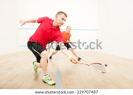 Two men playing match of squash. Closeup of squash players in action on squash court  Сток-фото ©