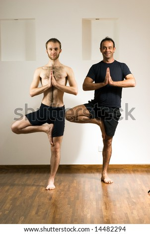 Two Men practice yoga